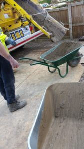 Transporting Concrete With Wheelbarrows